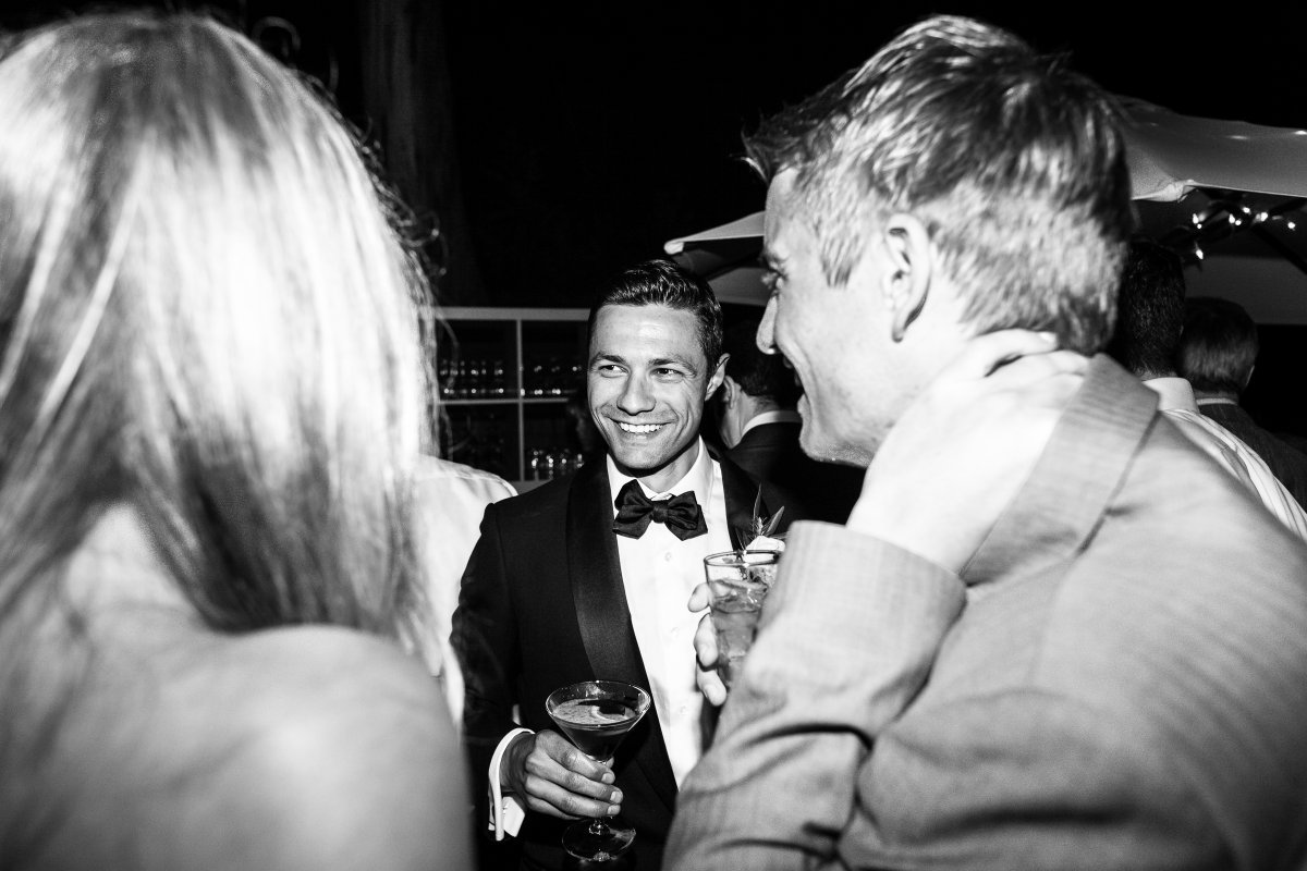 groom with martini socializing