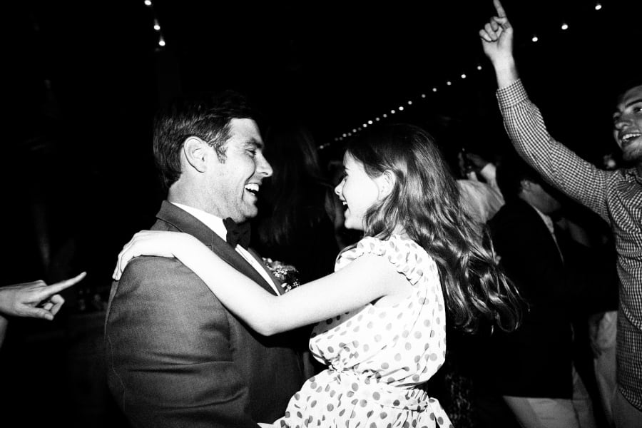 groom dancing with kid