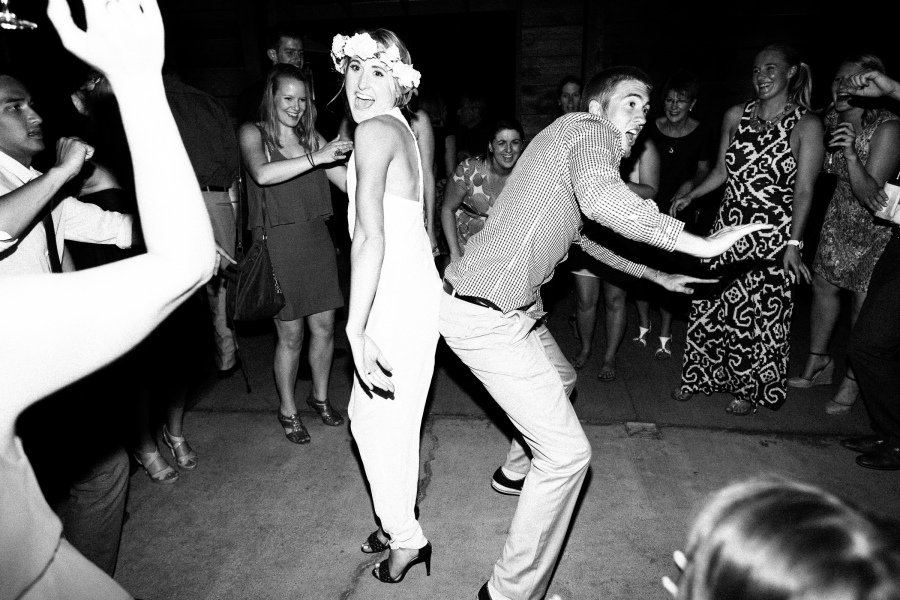 bride and brother doing funny dance