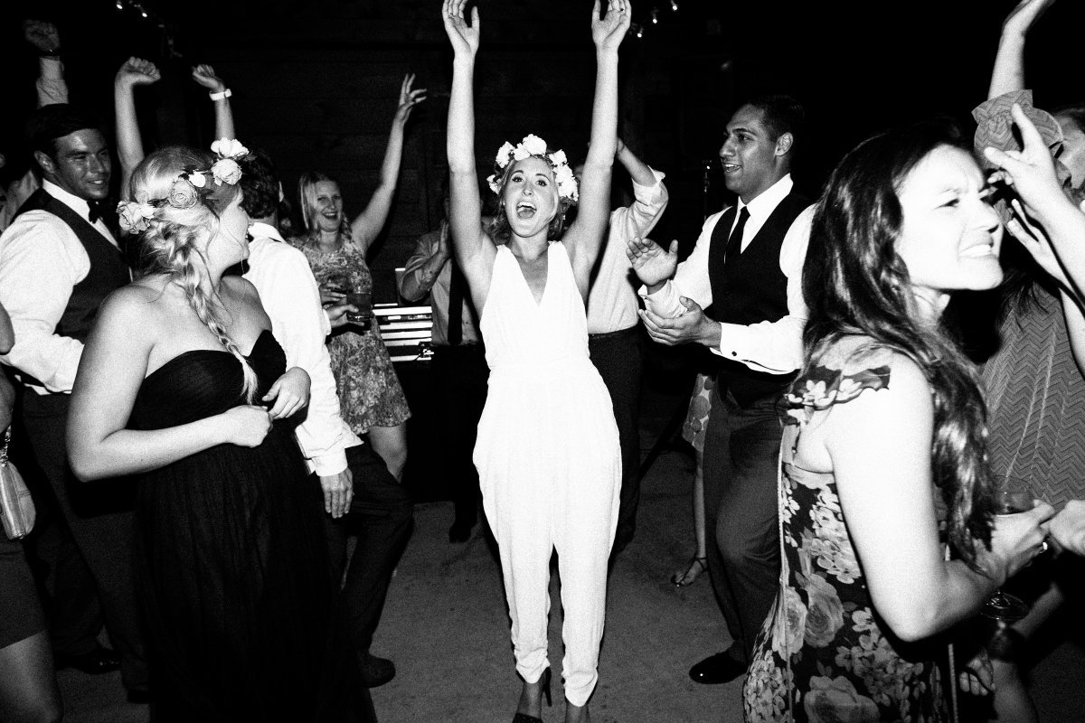 bride waving hands in the air dancing