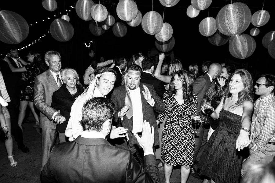 men dancing wiht ties on head
