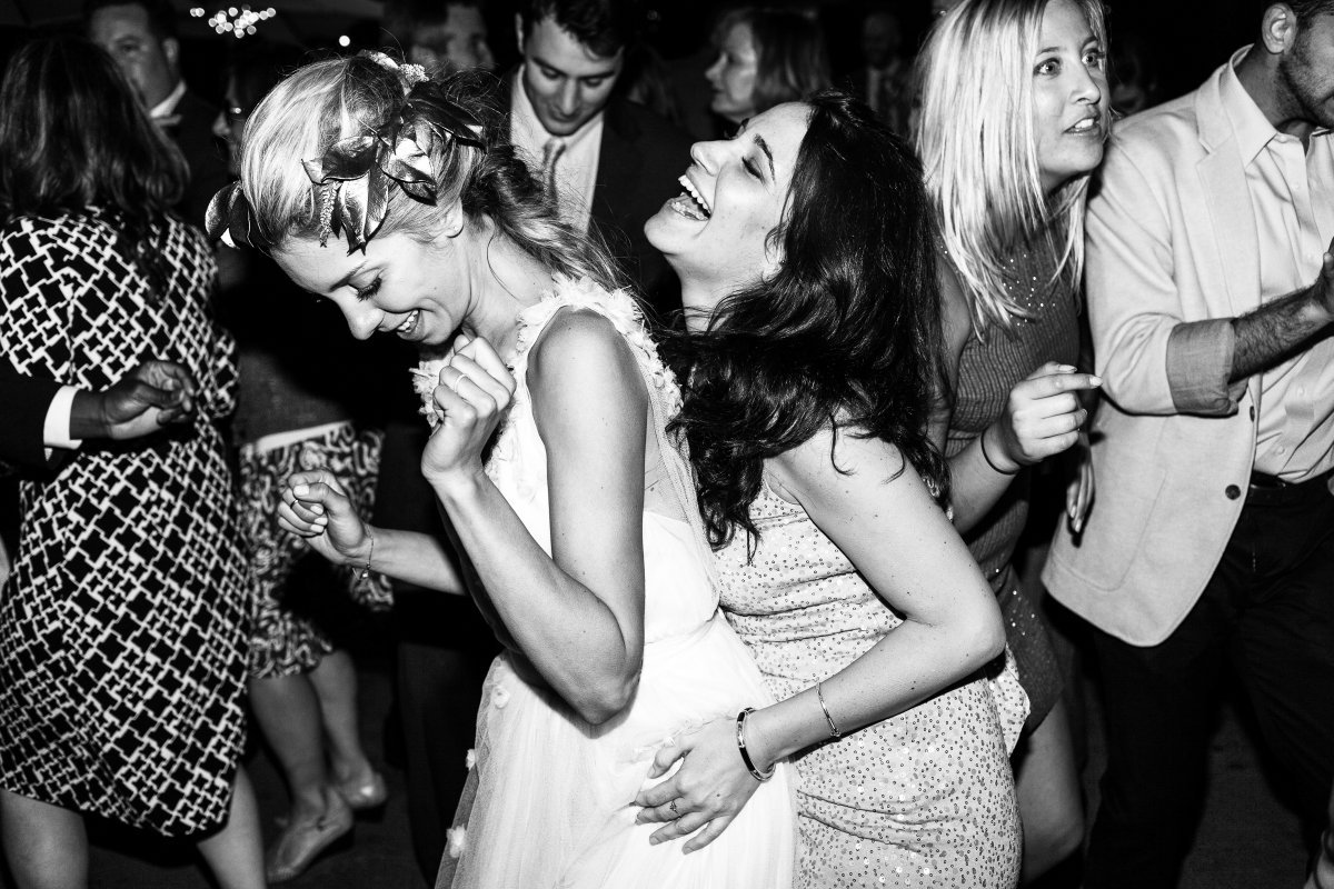 bride and maid of honor dancing