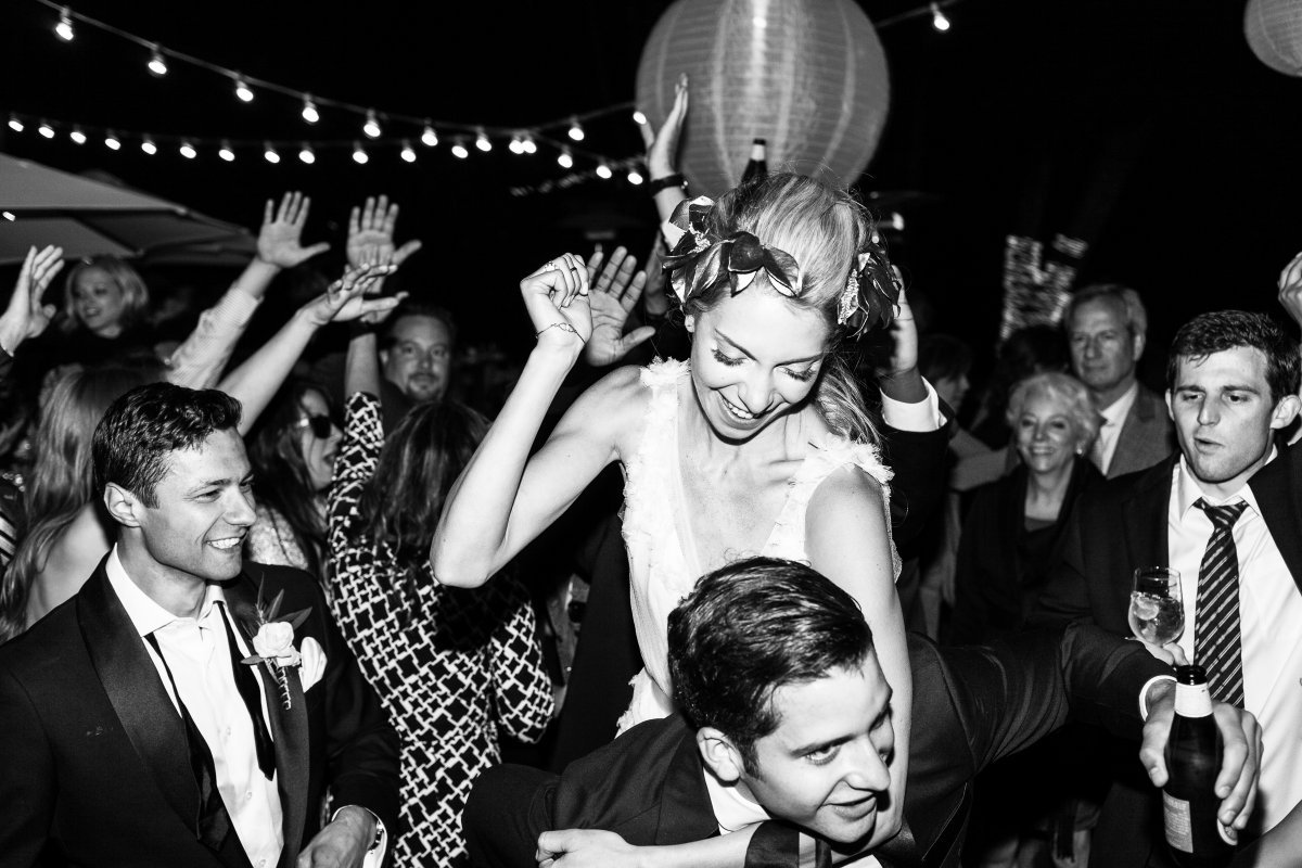 bride being carried on the dance floor