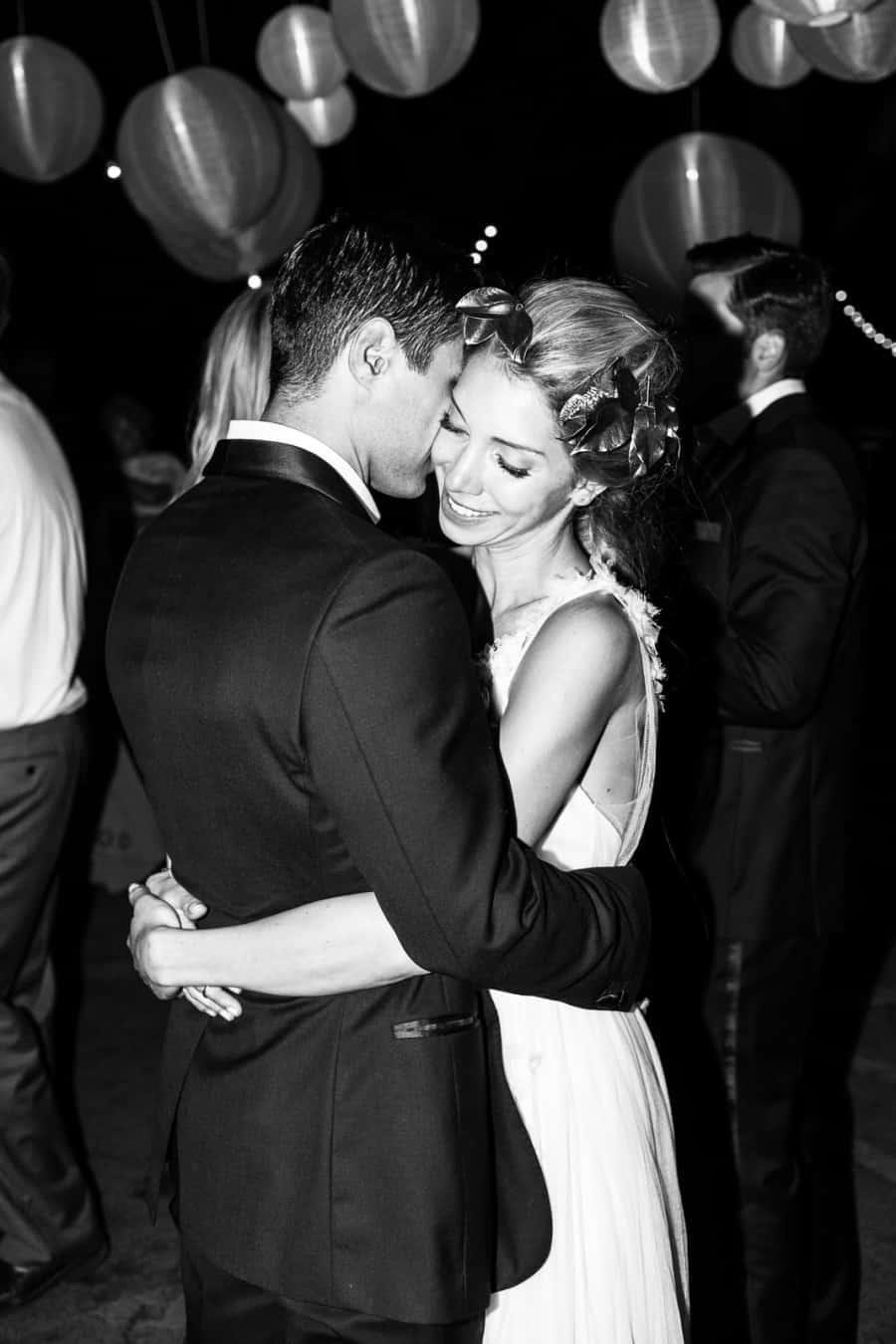 bride and groom slow dancing