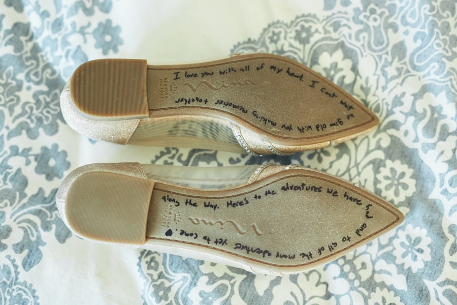 Bride's shoes with note on the bottom