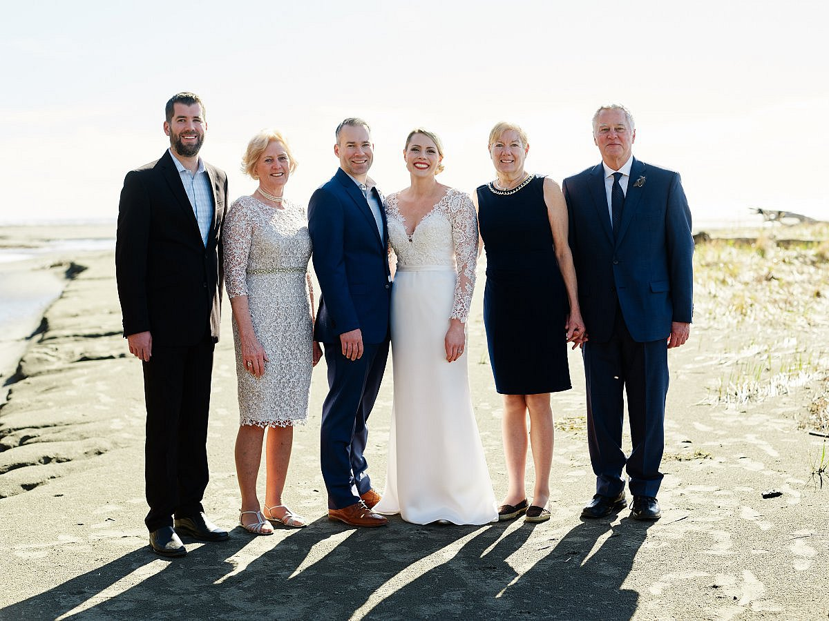formal group portrait on beach