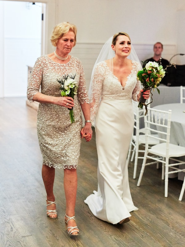 mom walking bride down aisle