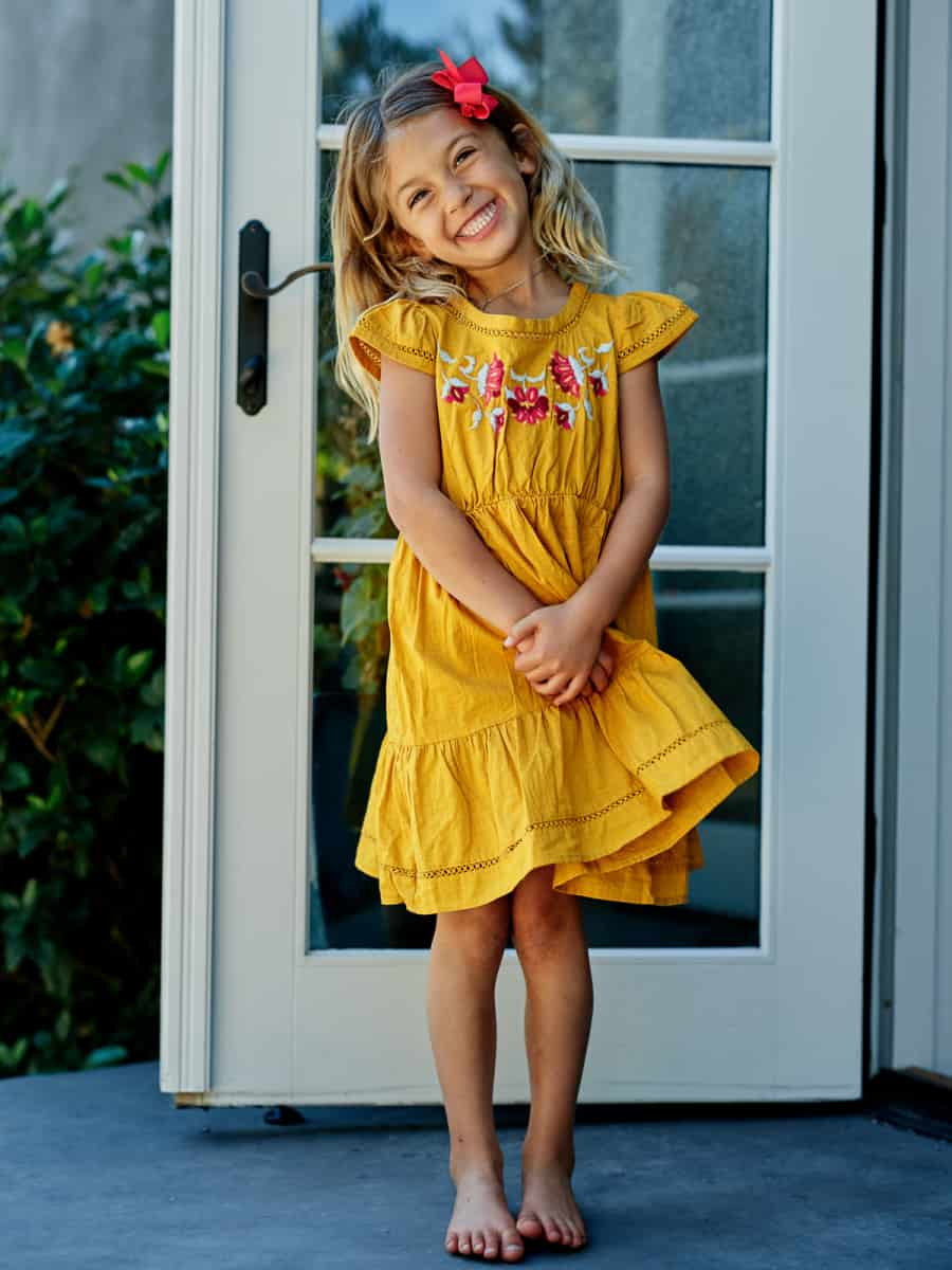 girl standing and smiling