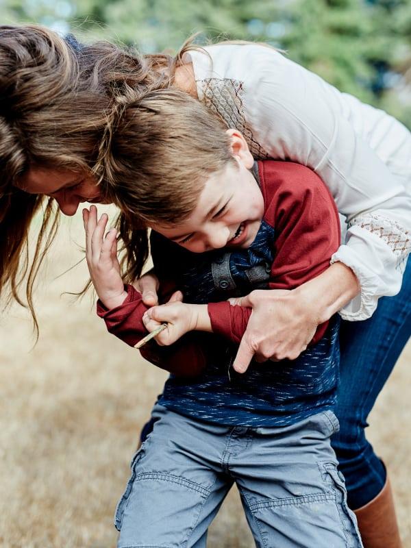 mom tickling son