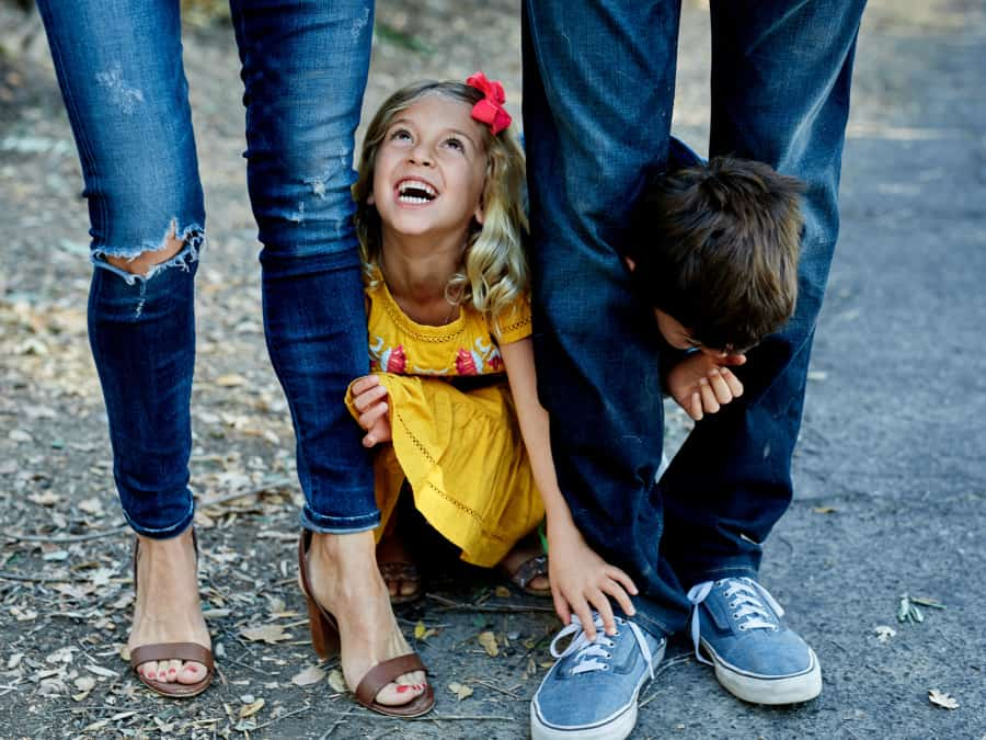 kids playing under parent's legs