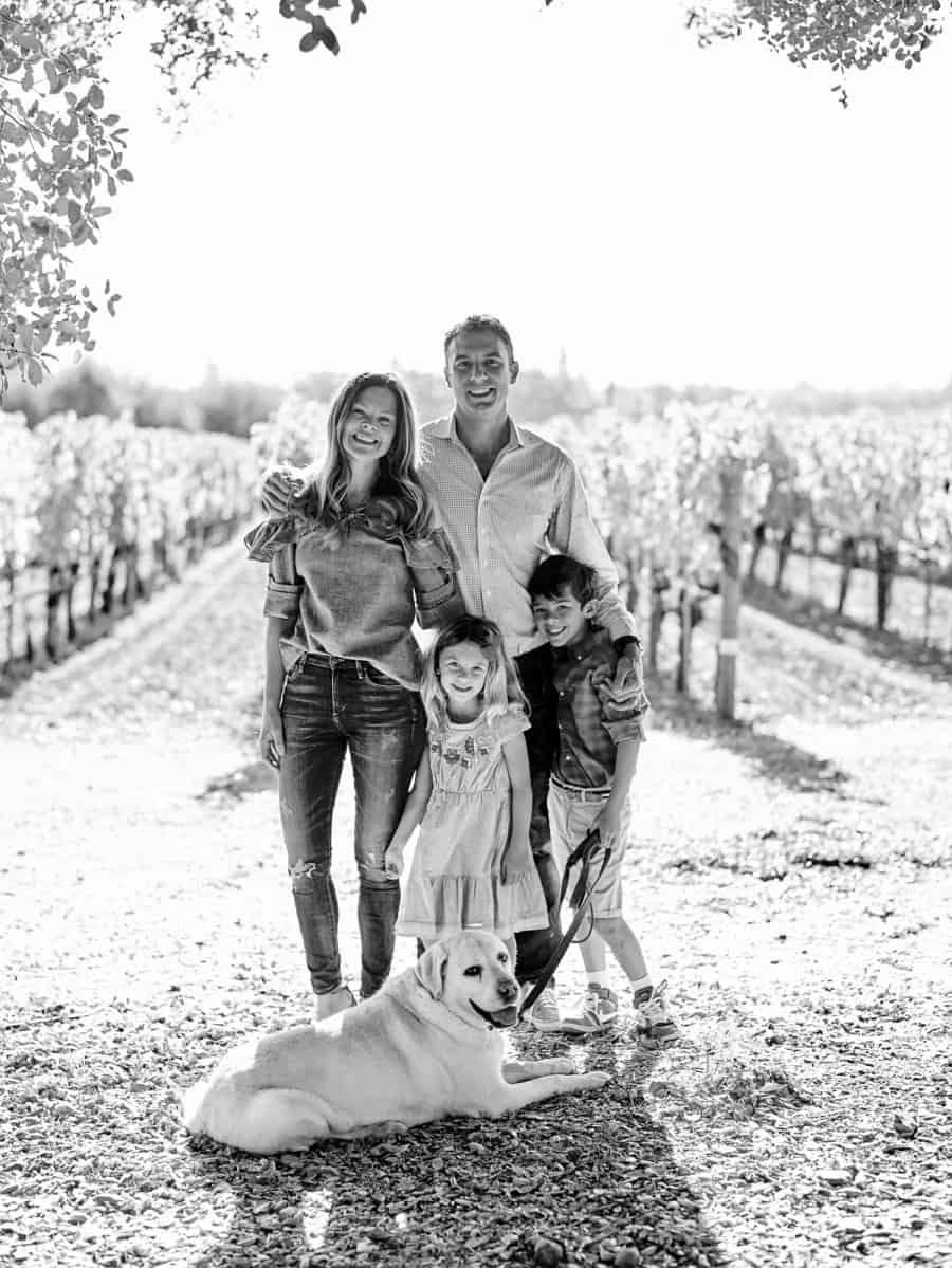 group family photo in front of vineyard