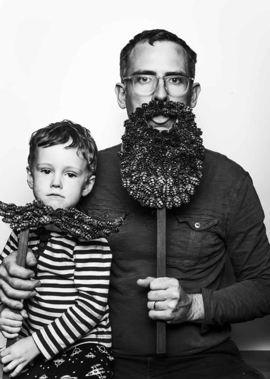 Cooper Carras in photo booth with son