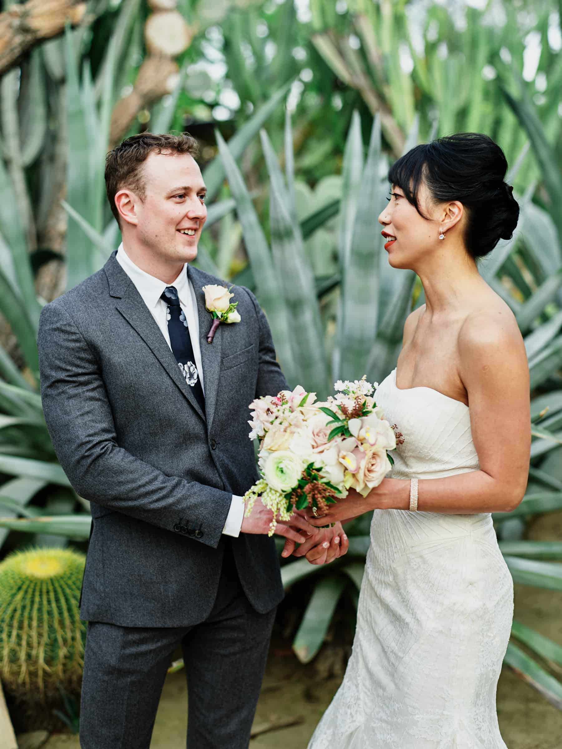 couple in front of cactus and giant agave plant