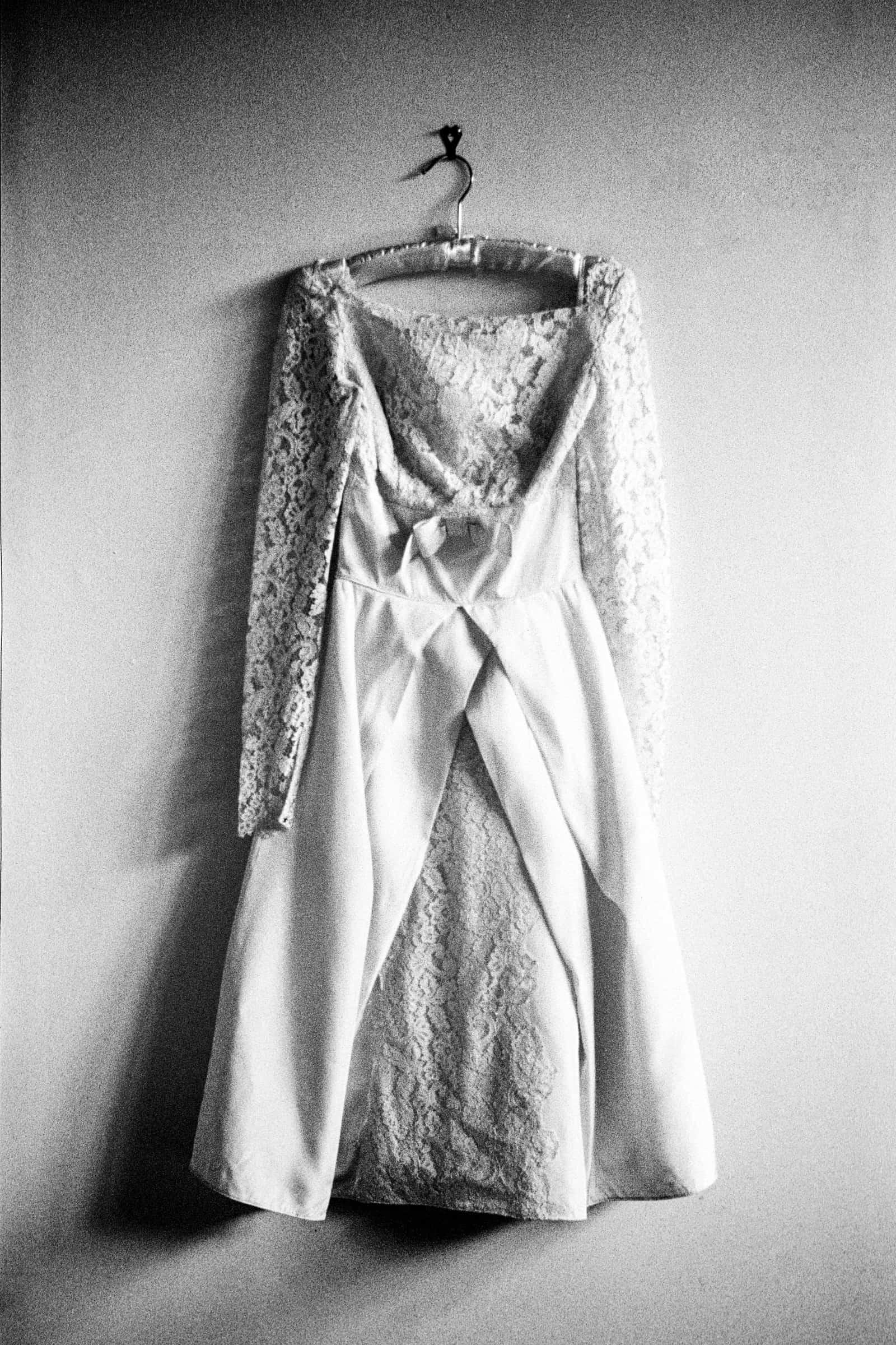 tea length wedding dress hanging on the wall