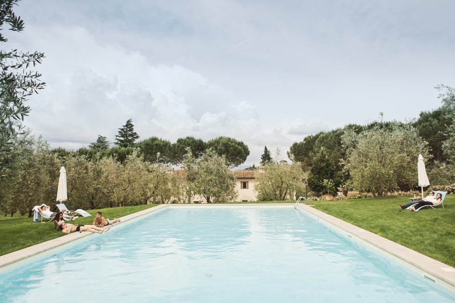 pool and people at Villa Poggio ai Merli