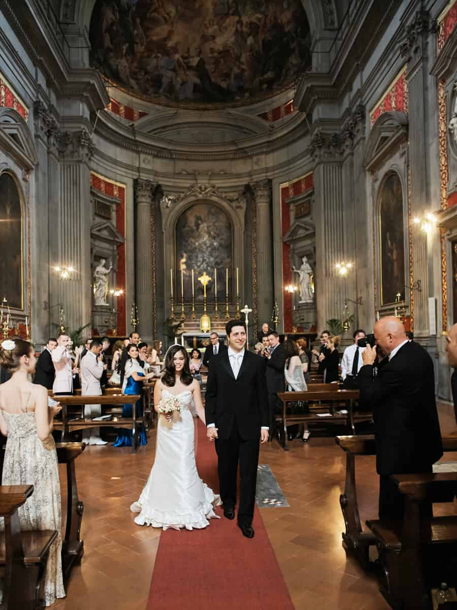 married couple walking in Santa Trinita church