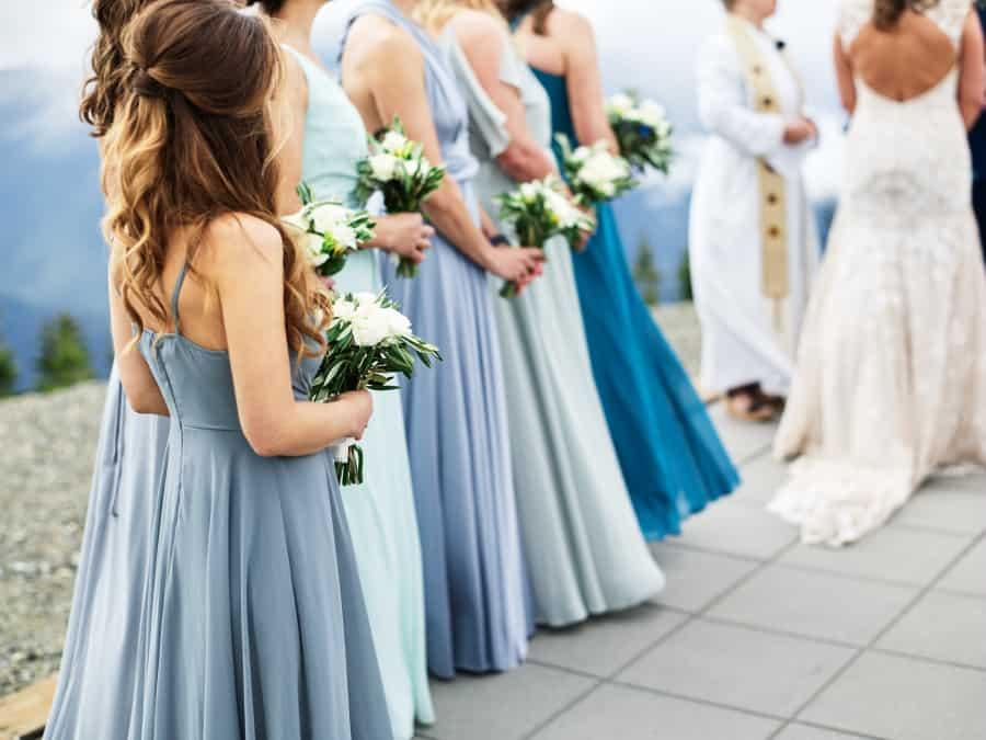 bridesmaids in blue mismatched dresses