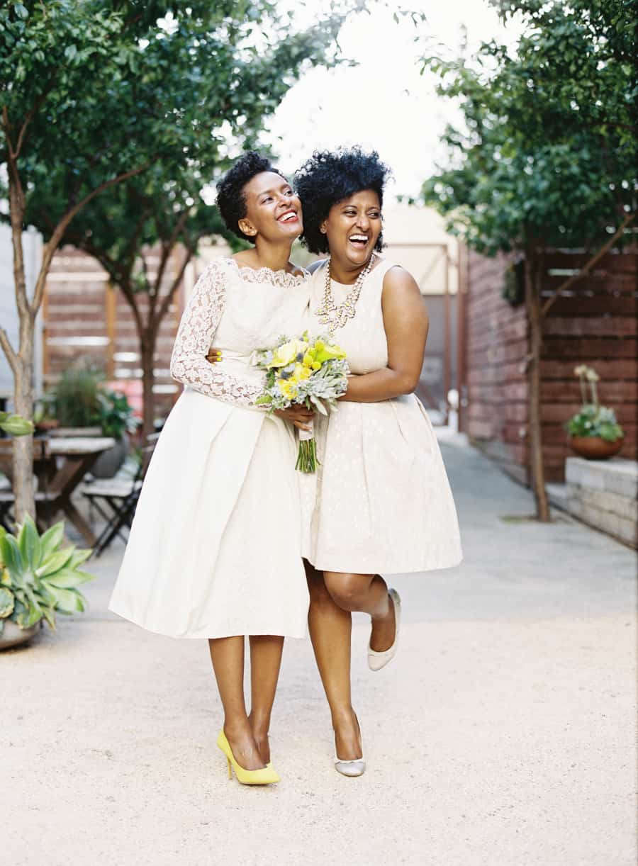 african american  bride and bridesmaid in short dresses