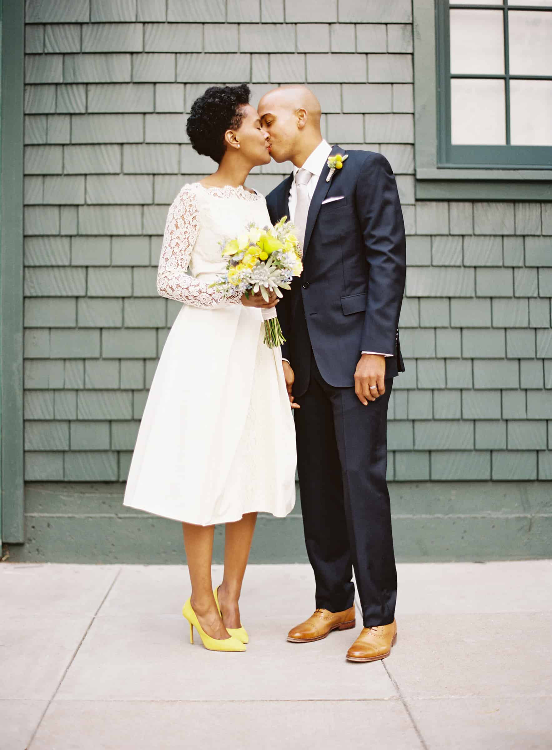 wedding couple portait with bride in yellow high heels and short dress