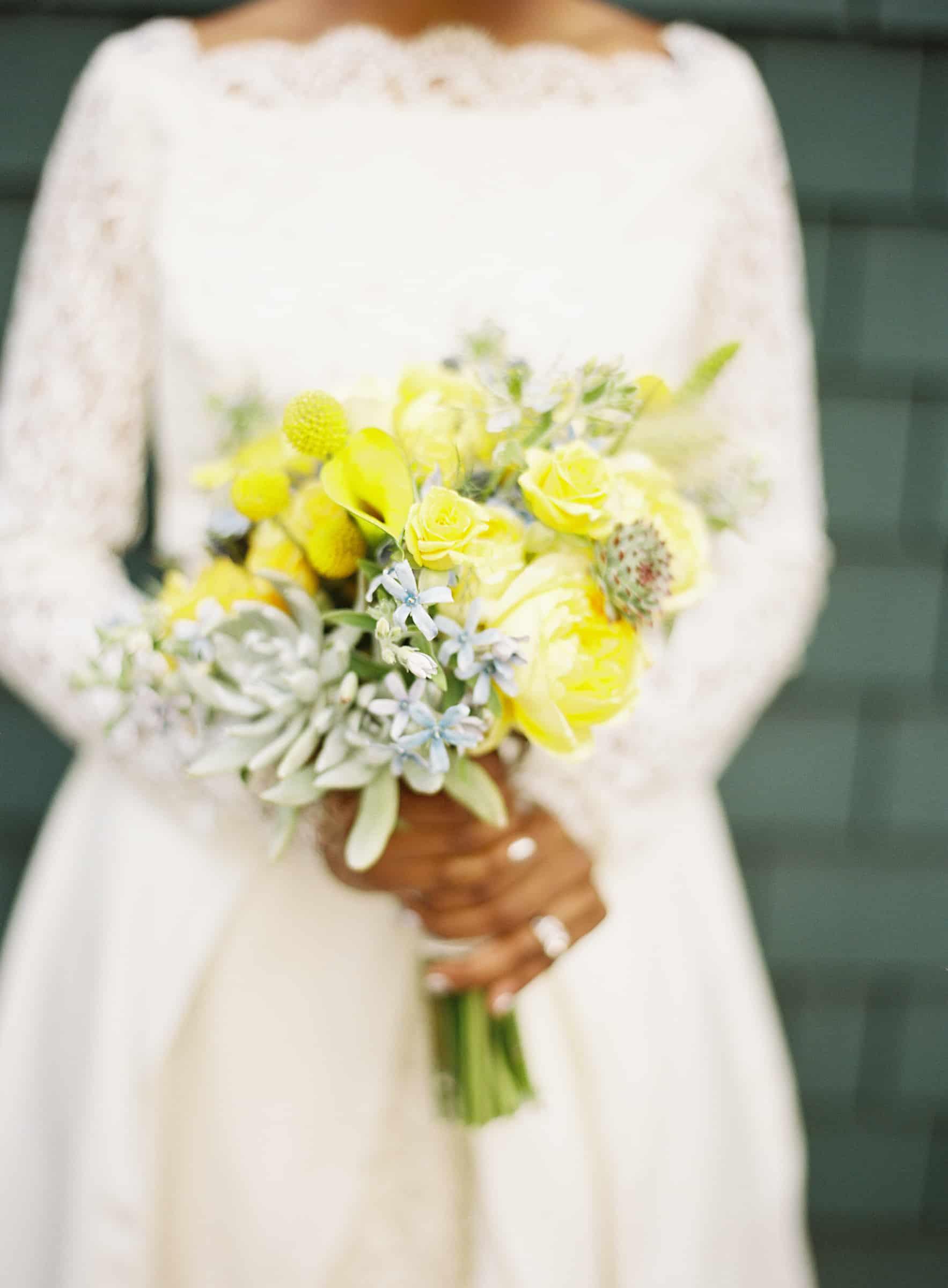 Closeup of bride holdign yellow bouquet