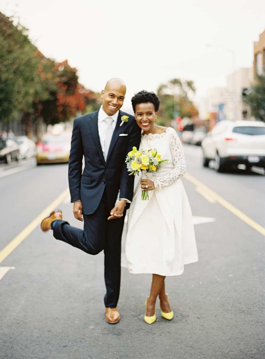Married couple posing in the street
