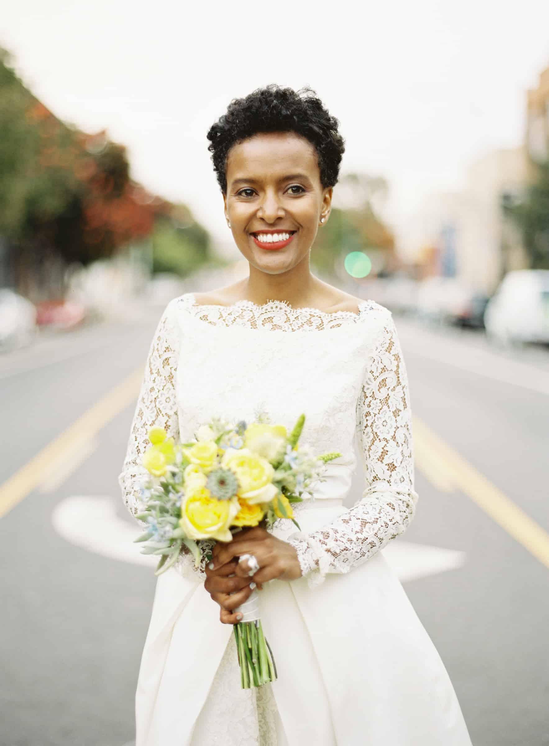 African american bride posing in the city street
