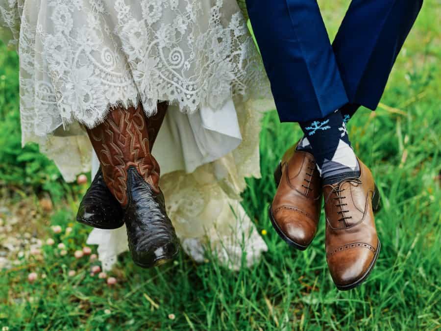 bride in cowboy boots and groom snowflake socks