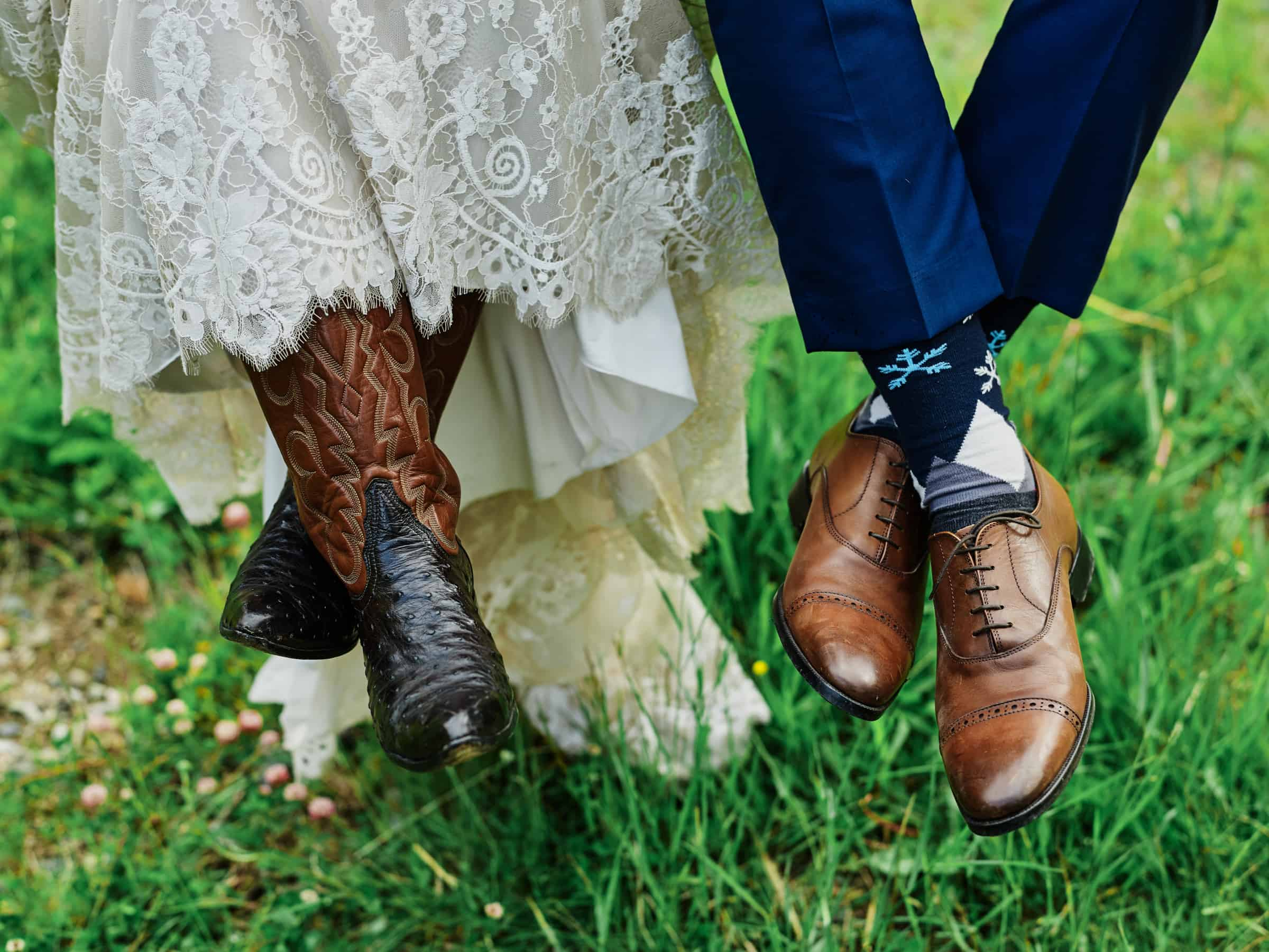 bride in cowboy boots and groom snowflake socks
