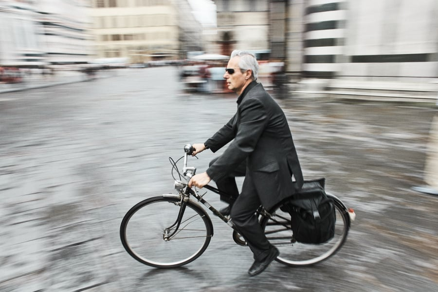 man riding bike near Cathedral of Santa Maria del Fiore