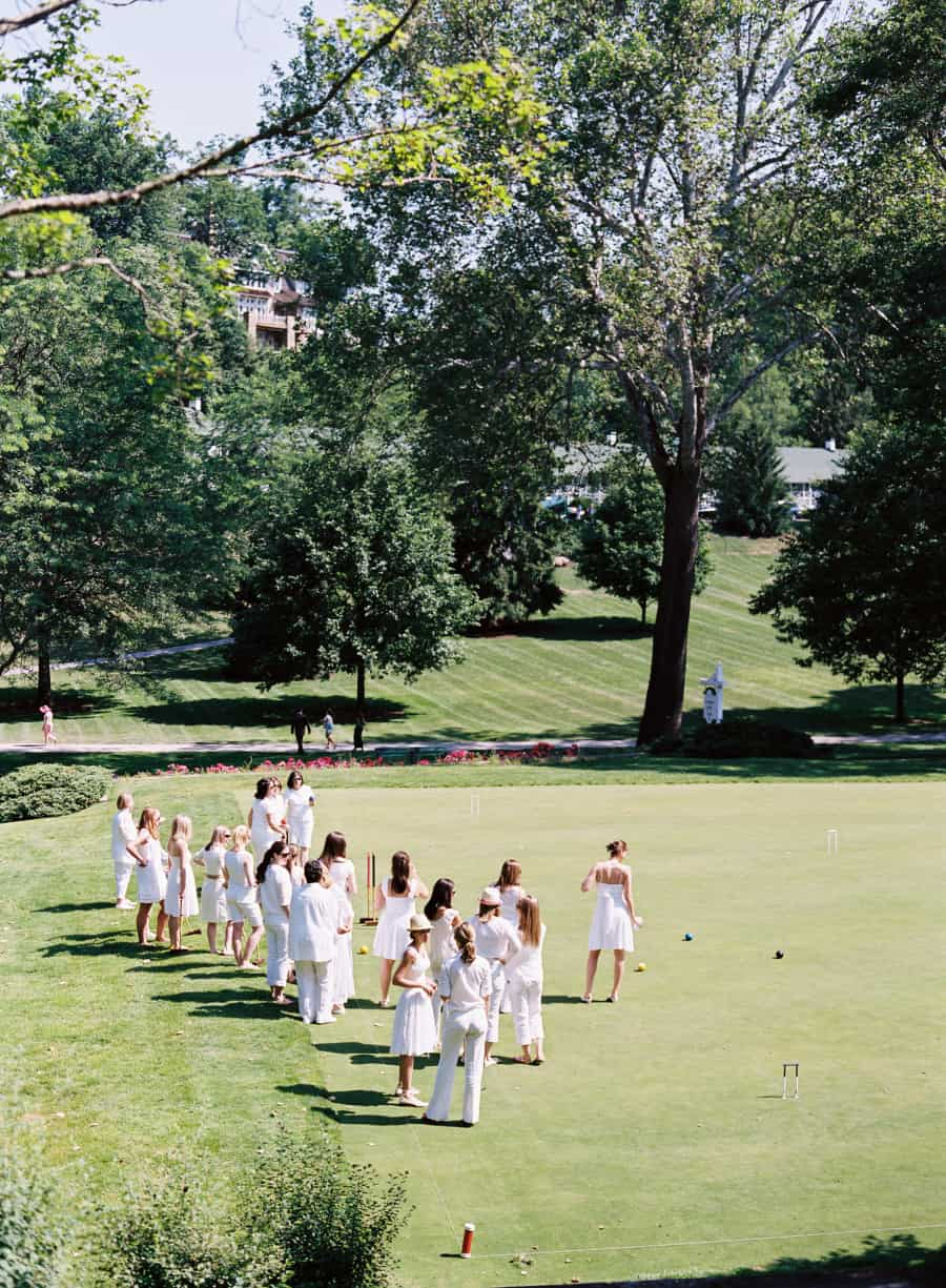bride and ladies playing croquet