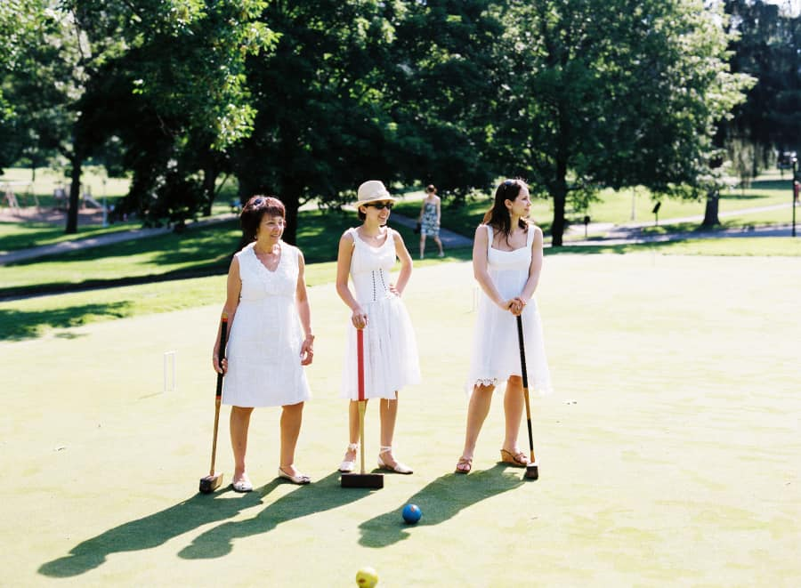 bride and guests playing croquet