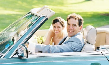 married couple in vintage mercedes-benz 560 SL