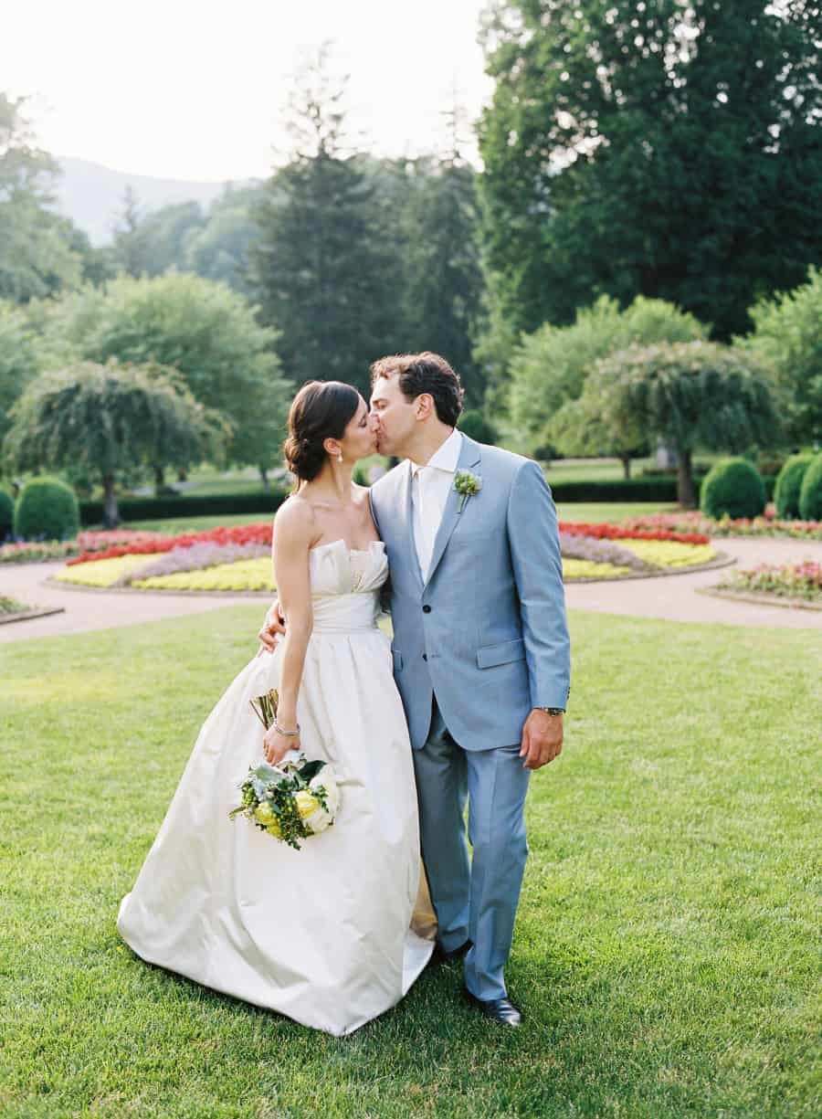 bride and groom kissing and walking at Greenbrier resort