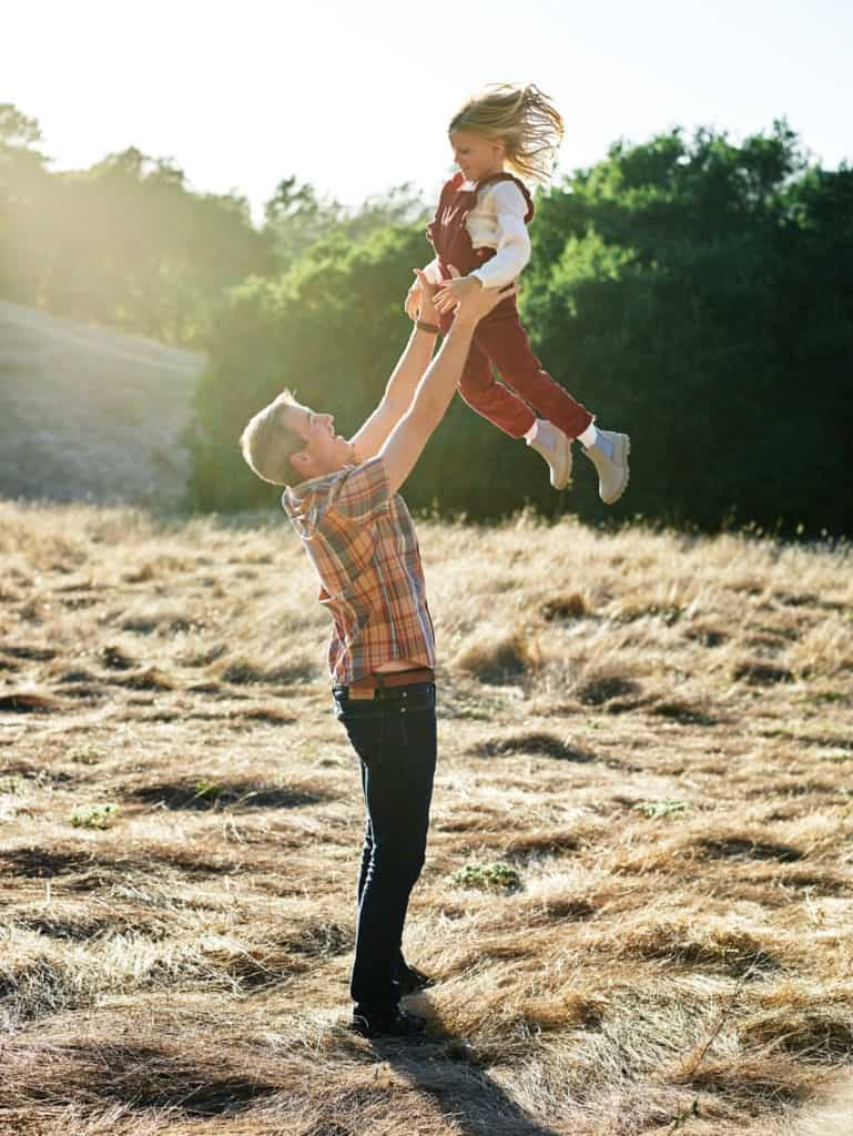 dad tossing daughter in the air during napa family session