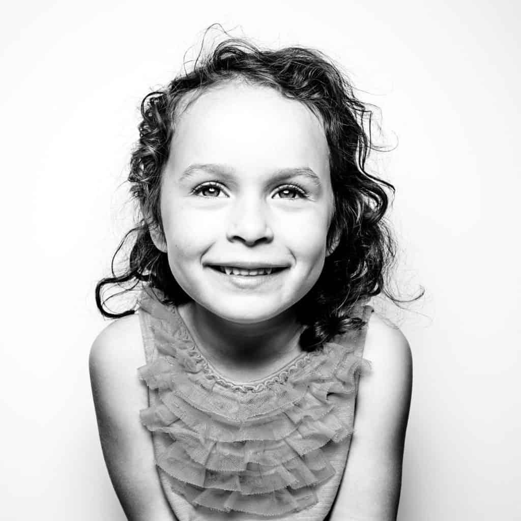 black and white studio portrait of girl