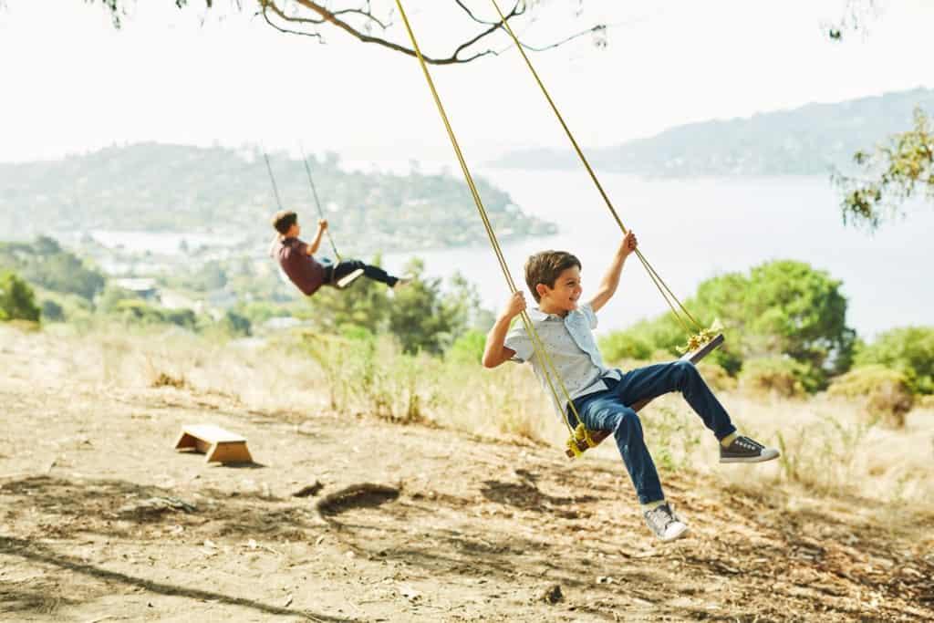 kids swinging at Hippie Tree in Tiburon