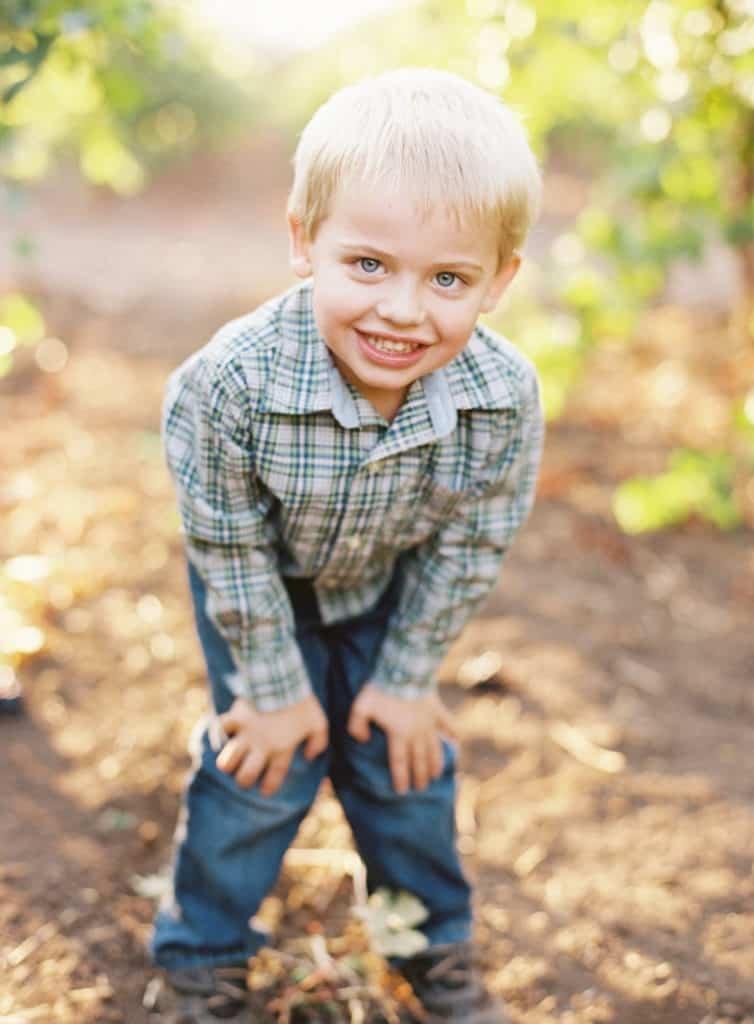 Boy posing for photo in vineyard