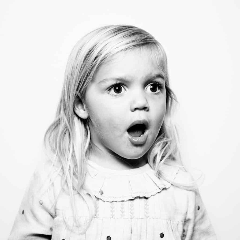 kids studio portrait of girl looking surprised