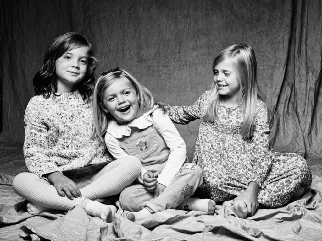 girls posing for studio portrait
